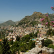 Taormina view of the old town from the greek amphitheater. Sicil — Stock Photo