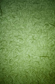 Green background with pattern and lens vignetting. (vertical)  — Stock Photo
