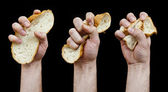 Diet concept. Photo Phase a hand crumple a slice of bread.  — Stock Photo