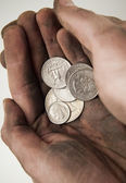 Fistful of Dollar coins — Stock Photo