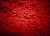 Red background with crumpled pattern and lens vignetting. (horiz — Stock Photo