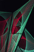 Red and green lights created 3D formation in black background — Stock Photo