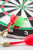 Dart board with darts — Stock Photo