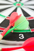 Dart board with darts — Stock Photo