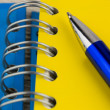 Spiral notebook and pen — Stock Photo