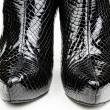 Black female crocodile boots isolated on white — Stock Photo