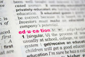Word education from the old dictionary, a close up — Stock Photo