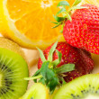 Display of fresh fruit on brightly coloured background — Stock Photo