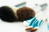 Professional makeup brushes on white — Stock Photo