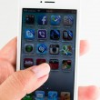 IPhone 5 in a hand isolated on white — Stock Photo #27778733
