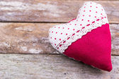 Red textile heart on wooden background — Stock Photo