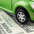 Toy car and money over white Rent, buy or insurance car concept — Stock Photo