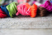 Colorful cotton craft threads on wood background with copy space — Stock Photo