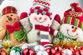 Christmas and New Year snowmen with toys — Stock Photo