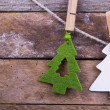 Stock Photo: Fir tree toys laying on wooden background