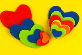 Colorful hearts stickers background on yellow Valentine decorations — Foto de Stock