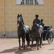 Sculpture of horses and min cart — Stockfoto #26052573