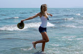 Young girl have fun on the beach — Stock Photo