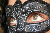 Photo of a young woman wearing mask — Stock Photo