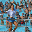 Постер, плакат: Entertainers dancing on the edge of a pool