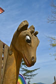 Giraffe head carved in wood — Stockfoto