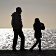 Stock Photo: Figures backlight on beach