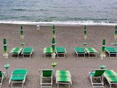 Deck chairs. palm trees. beach. roads. alleys. arches. Liguria. Italy. outdoor. holidays. relaxation. — Stock Photo