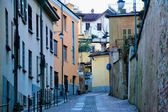 Rivoli. Turin. Italy. homes. roads. courtyards. window. door. lights and streetlights. winter. outdoor. people. walk. — Stock Photo