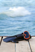 Scuba diving fins on the bridge — Foto Stock