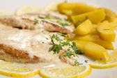 Chicken steak with sause and potatoes — Stock Photo