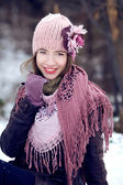 Young girl smiling in winter clothes — Stock Photo