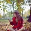Happy hipster girl with cell phone — Zdjęcie stockowe