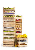 Fruit stored in wooden crates on white background — Stock Photo