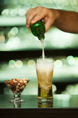 Pouring beer in glass — Stock Photo