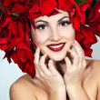 Portrait of beautiful woman with stylish makeup and red xmas flo - Stock Photo