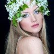 Stock Photo: Beautiful young woman with fresh spring flowers in her hair