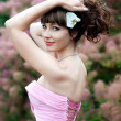 Stock Photo: Beautiful harmonous woman in a long pink dress. Bride