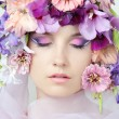 Portrait of beautiful girl with stylish makeup and violet flower - Stock Photo