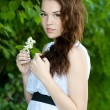 Beautiful  girl with flower — Stock Photo #22256025