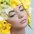 Portrait of beautiful girl with stylish makeup and yellow flower — Stock Photo