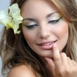 Portrait of beautiful girl with stylish makeup and flower in he - Stock Photo