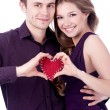 Young couple forming heart shape with their hands isolated on wh — Stock Photo