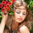Beautiful woman in garden with flowers — Stock Photo