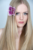 Beautiful woman with long straight blond hair — Stock Photo