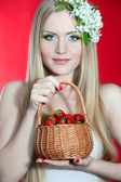 A woman eating a strawberry — Stock Photo