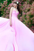 Beautiful harmonous woman in a long pink dress. Bride — Stock Photo