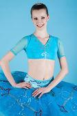 Portrait of a ballerina dancer making a ballet on blue backgro — Stock Photo
