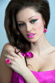 """Beautiful woman in a pink dress with decorations """"rose"""" — Stock Photo"""
