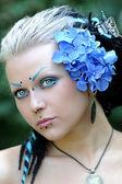 Beautiful young woman with dreadlocks — Stock Photo