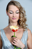 Girl with tulip — Stock Photo